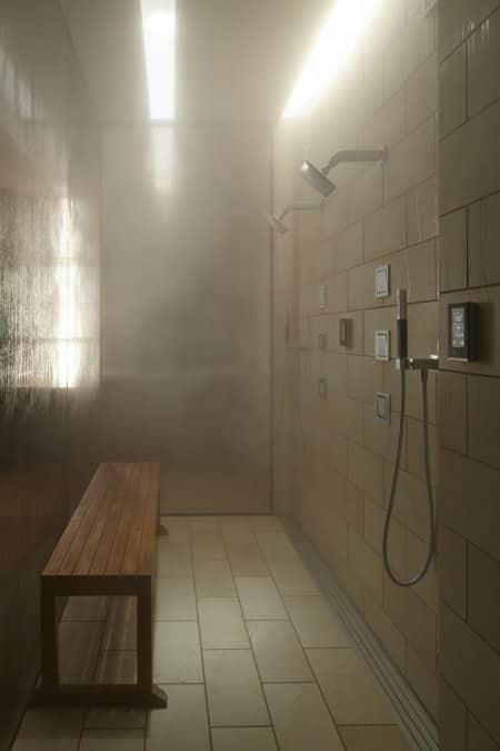 steam shower with bench and controls on wall