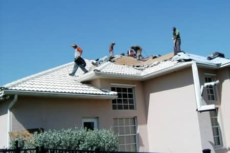 roofers ripping off old tile roof