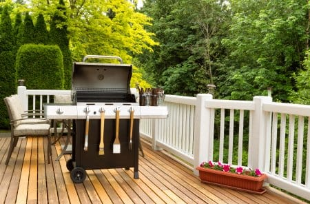 gas grill on wooden deck