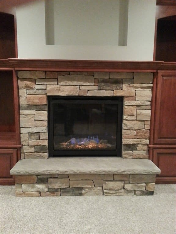 stone fireplace with hearth