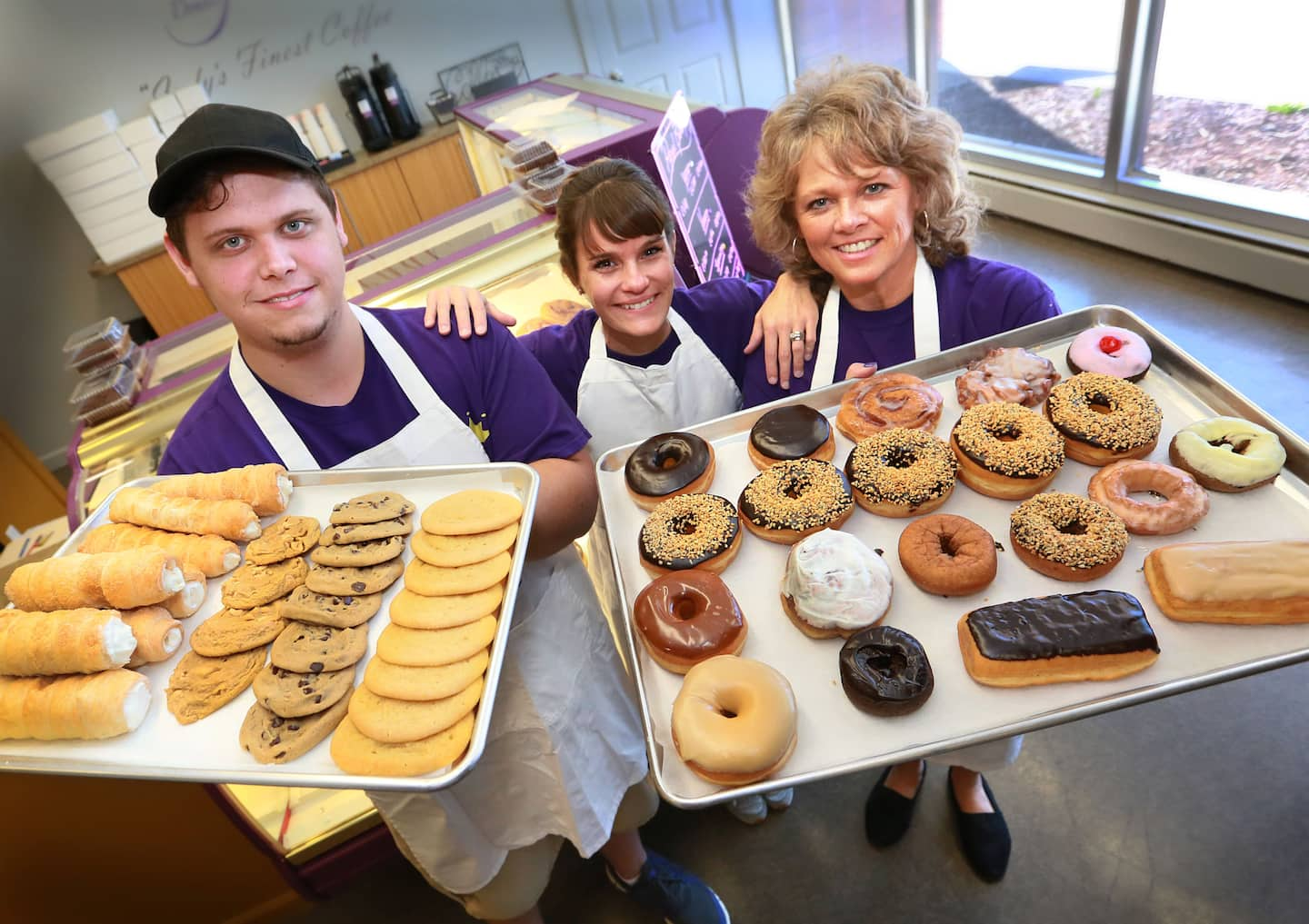 Sweet openings: The newest business in Beech Grove is Regal Donuts & Bakery, located at 624 Main Street. Pictured here, the owners and bakers, (from left) Devon Veerkamp, Rendy Arnold an Judy Veerkamp.