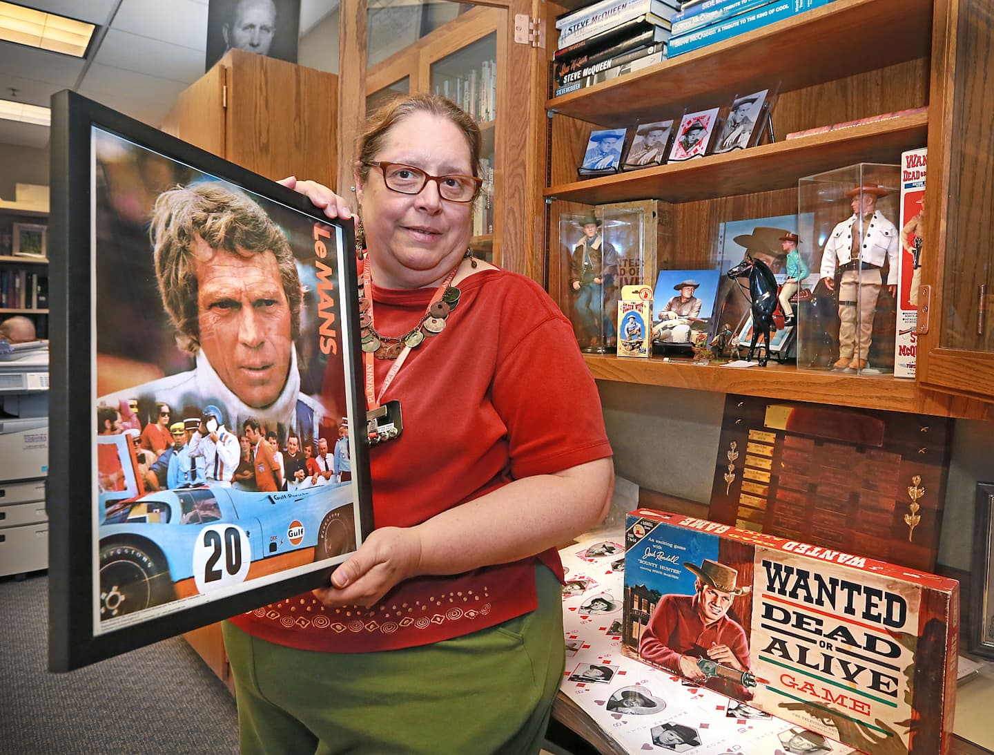 Michele Patterson, with the Beech Grove Historical Society, holds a framed movie poster from the 1971 film Le Mans starring Beech Grove native, Steve McQueen.