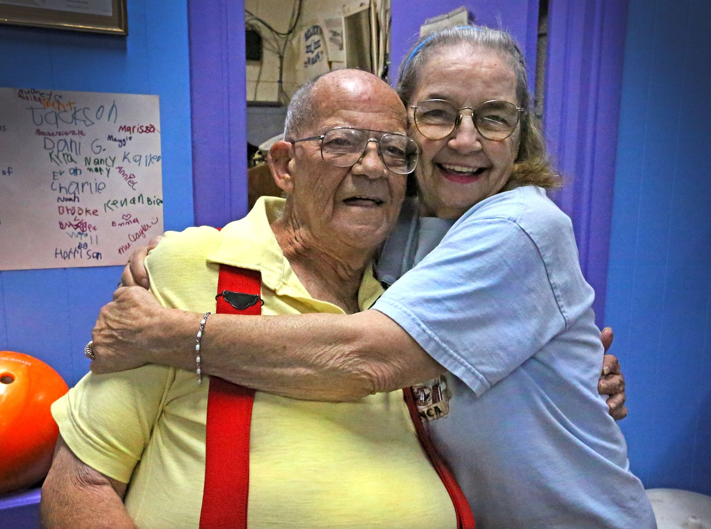"""Rita Hendricks (right) is one of the better local bowlers but is also known for making sure she hugs everyone in the establishment. Mark Howard gets his hug from Rita during  """"League Night"""" at the Beech Grove Bowl, 95 N 2nd Ave."""