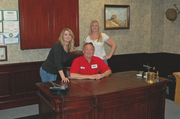 Jim Dickerson's daughters Debbie Whisnant (left) and Angie Cliffe (right) run the plumbing and electrical company he founded with his wife in 1977.. (Photo courtesy of Debbie Whisnant)