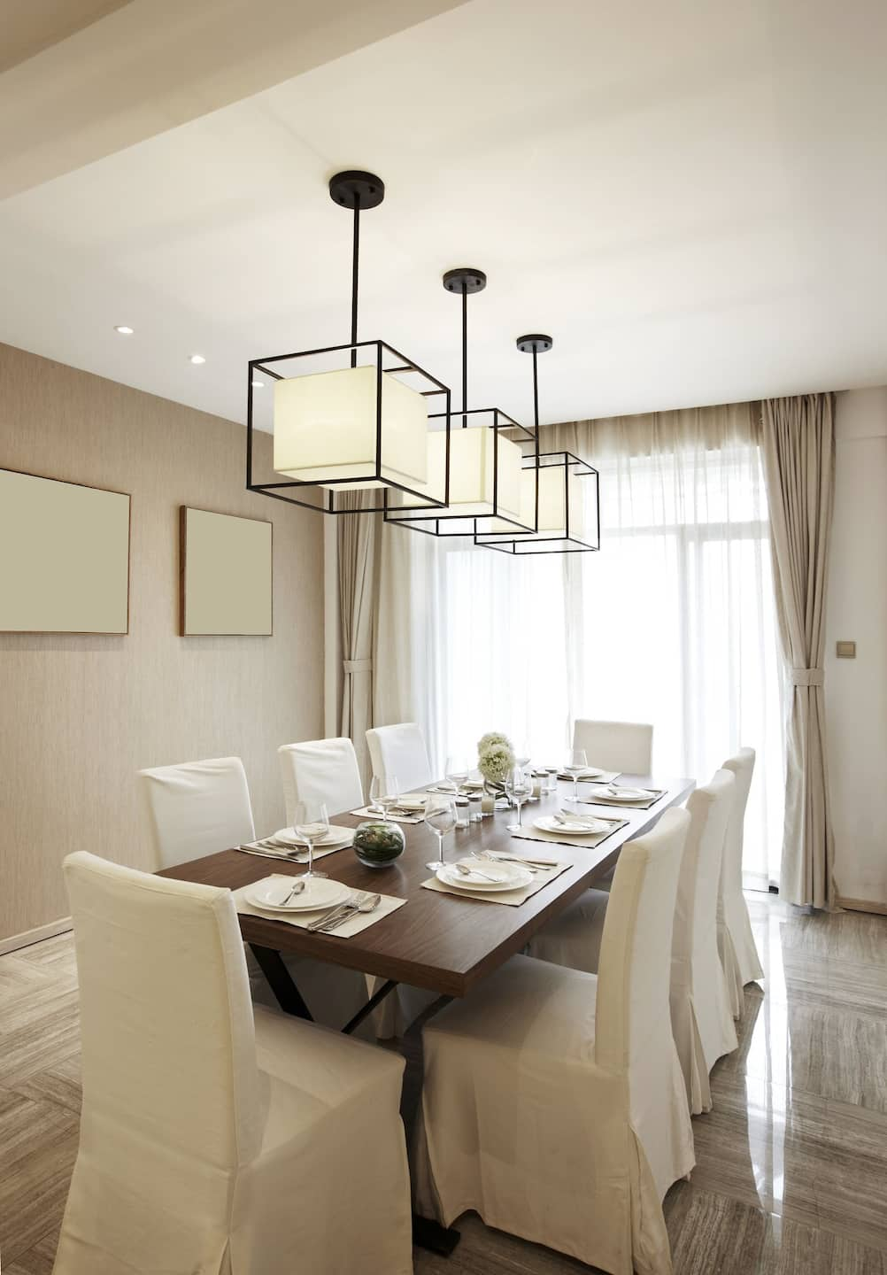 A Formal Dining Room Table With Three Cube Shaped Frames With White  Box Shaped. Like Chandeliers ...