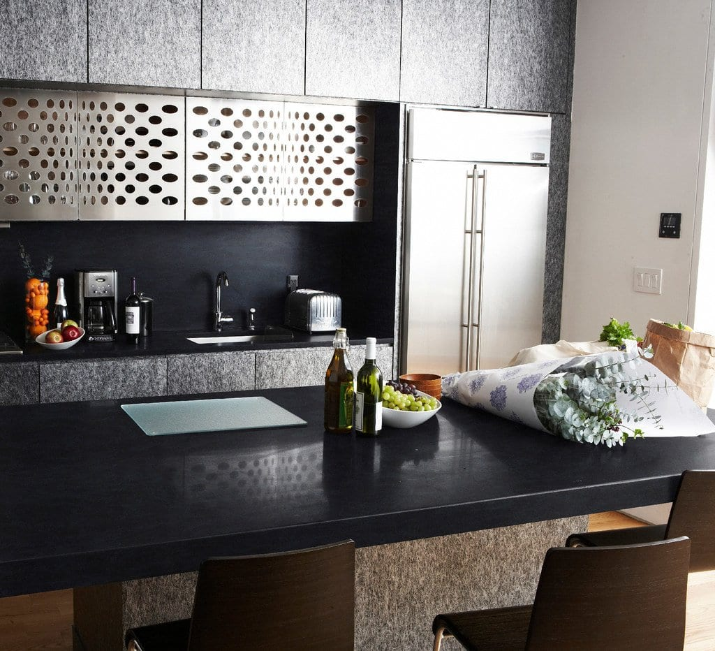 kitchen island with inkwell colored countertops