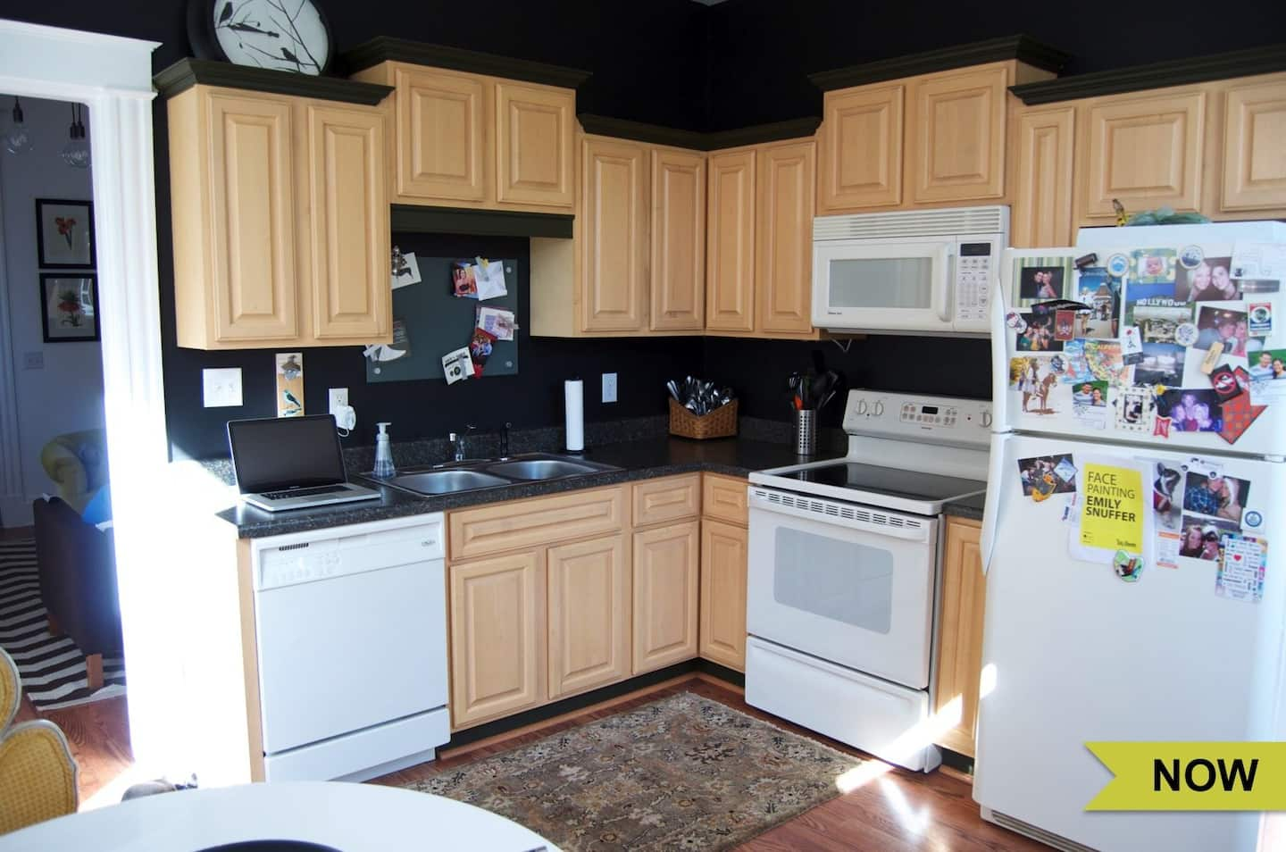 Small Kitchen With Light Wood Cabinets Dark Countertop And Backsplash