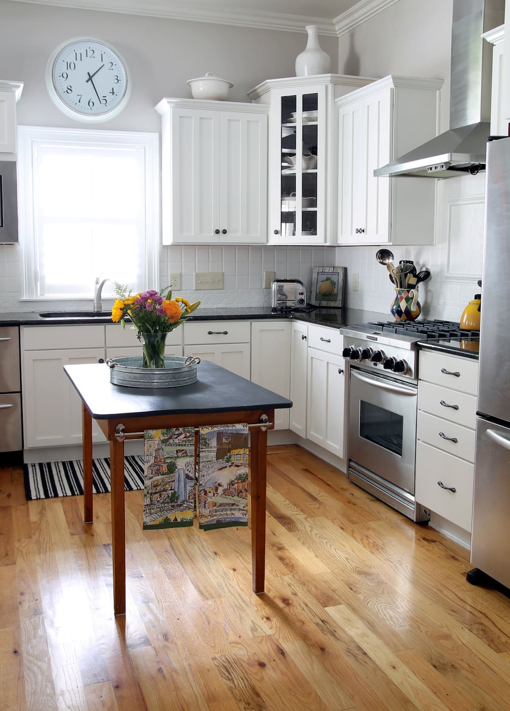 Kitchen with White Painted Cabinets and White Painted Backsplash