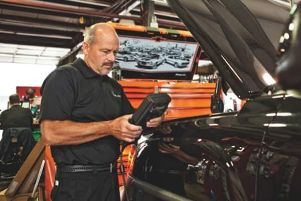 Keith Stockberger, owner of Miller Auto Care in Carmel, runs diagnostics on a vehicle. If you notice major leaks around your car, or experience other operating issues, take it to a qualified mechanic. (Photo by Brandon Smith)