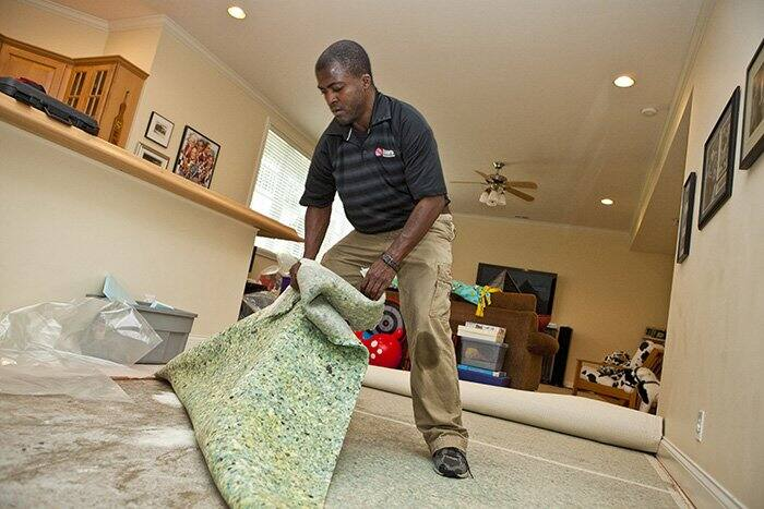 first step in cleaning a flooded home is to remove soggy carpet padding