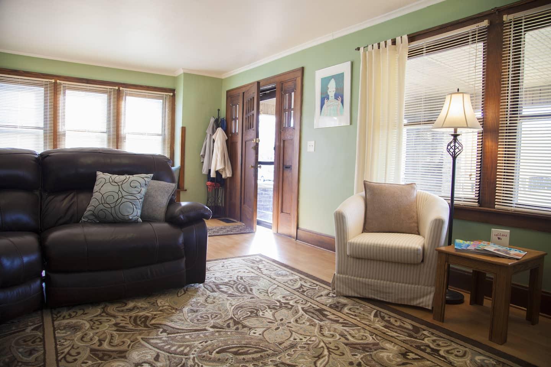 Living room with the front door ajar