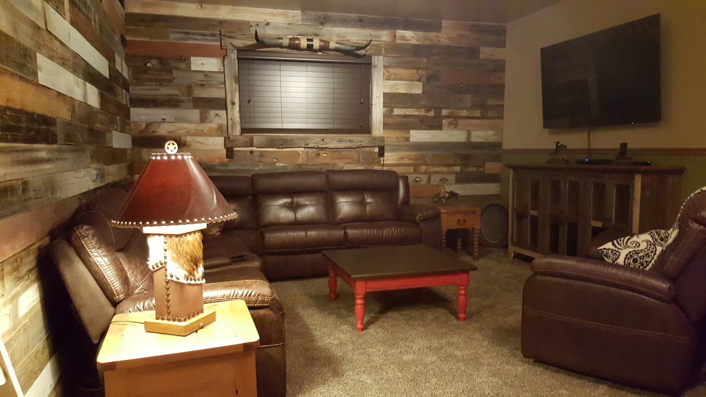 Mixing the old with the new was the logical choice in transforming this storage area into a family and game room.