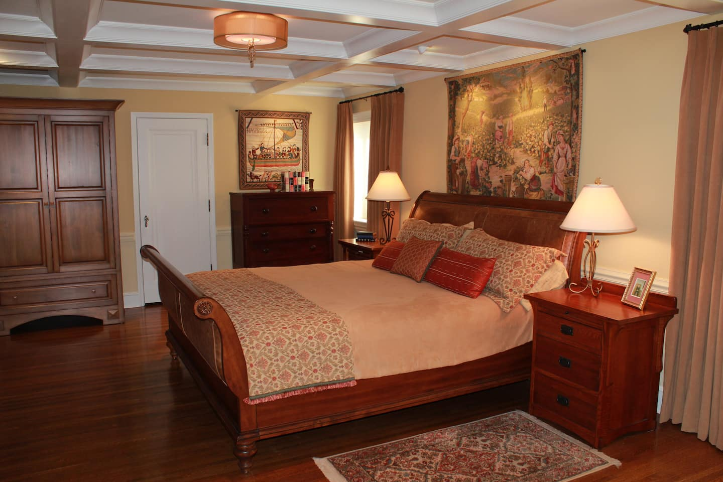 master bedroom with artwork and area rugs
