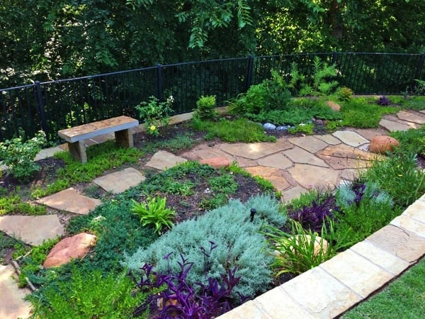 Flat stones enhance the look of the plant bed. (Photo courtesy of Angie's List member Yi C. of Oklahoma City)