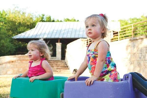 20-month-old twins Kathryn (L) and Samantha (R) Blevins spent three weeks in the NICU after a premature birth. (Photo by Eric Priddy)