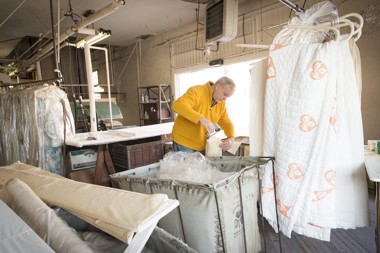 Underwood repairs a window valance.
