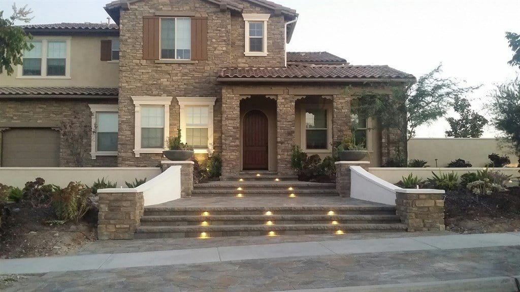 Stone front porch with bilevel steps and inset lights