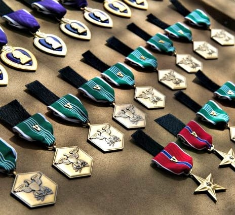 Dozens of military medals are on display at an event honoring servicemen. (Photo courtesy of the U.S. Army)