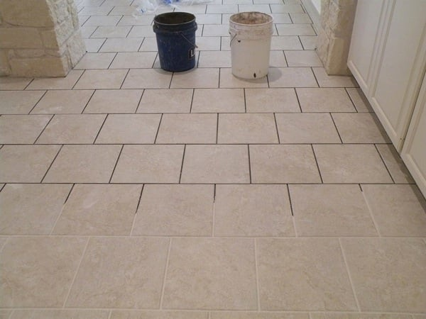 Petty Tile & Carpet used chisels and a jackhammer to help level the swollen slab floor before laying the new tile. (Photo courtesy of member Betty L of Georgetown,Texas)