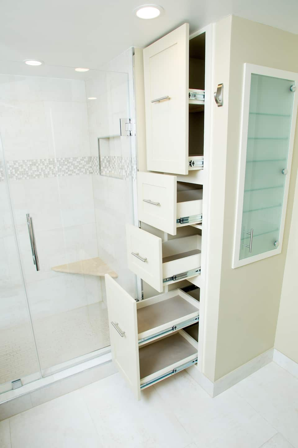 custom bathroom cabinets with recessed medicine cabinet and pullout drawers next to walk in shower - Bathroom Cabinets Ideas
