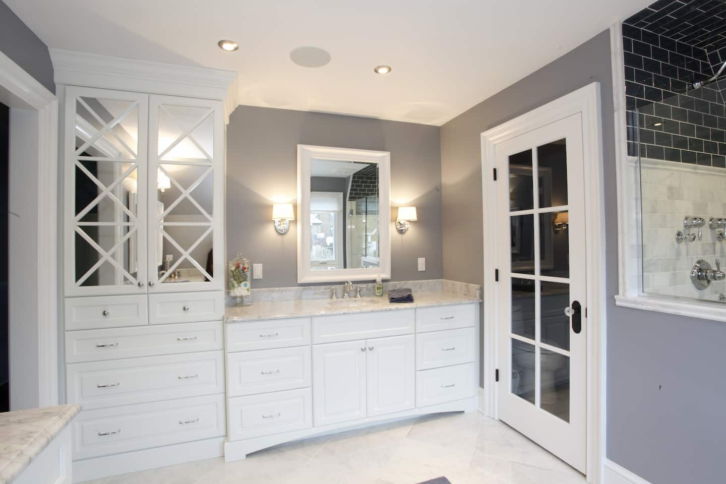 Remodeled Bathroom With White Cabinets And A Corner Tower Cabinet