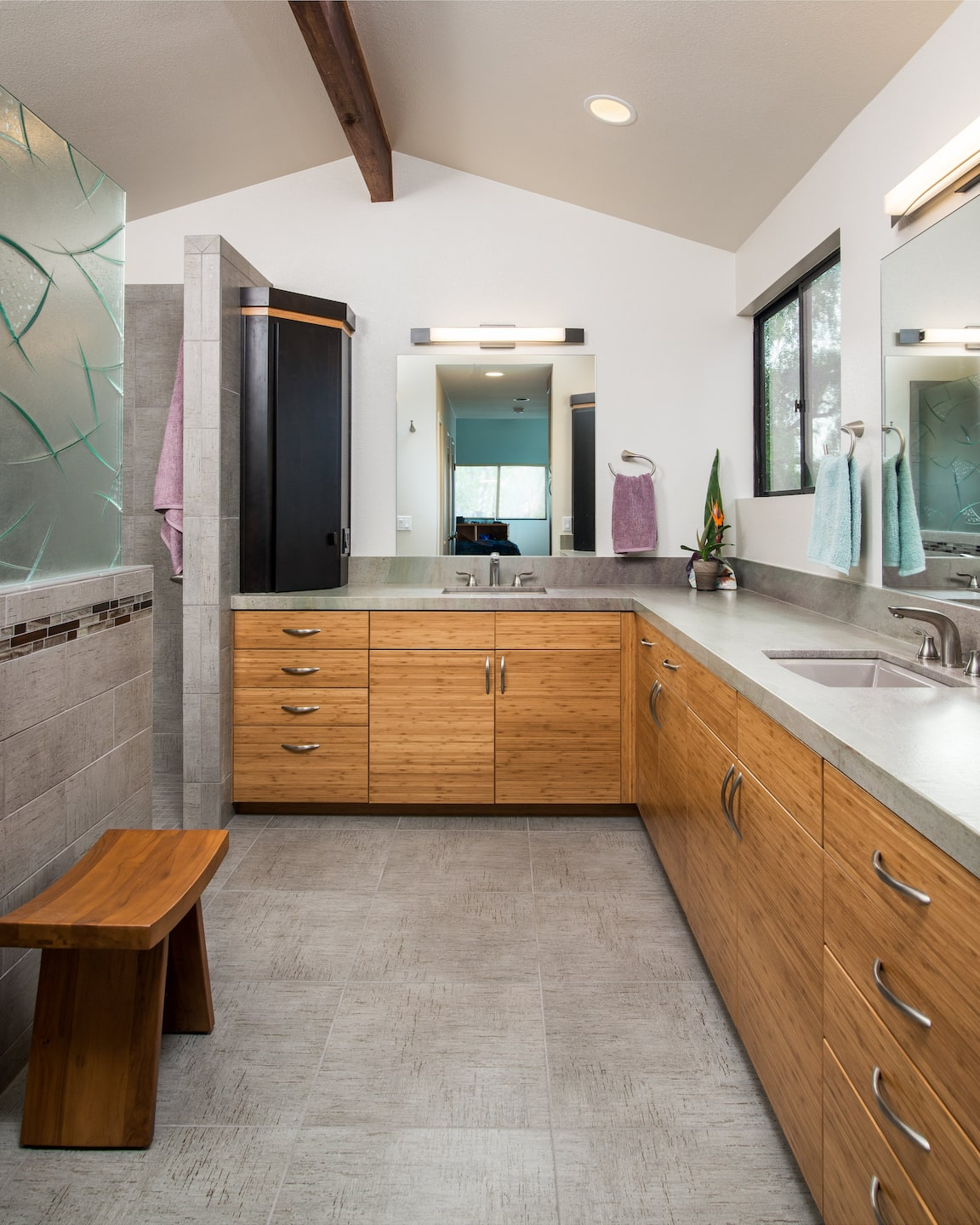 Remodeled Bathroom With Bamboo Cabinets, Grey Tile, Brushed Nickel Fixtures  And Walk In