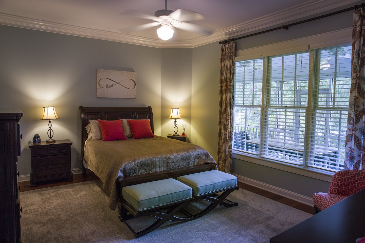 Southern style master bedroom with ceiling fan and lamps