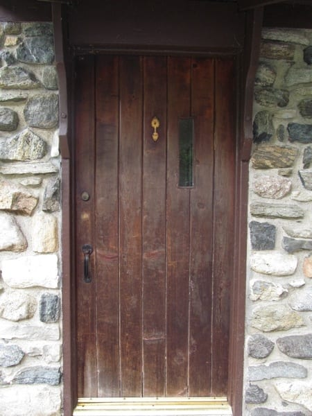 This 86-year-old door needed a facelift. It wouldn't open all the way, the latch was confusing, and the color faded. (Photo courtesy of Angie's List member Pat Tallia of Sparta, N.J.)