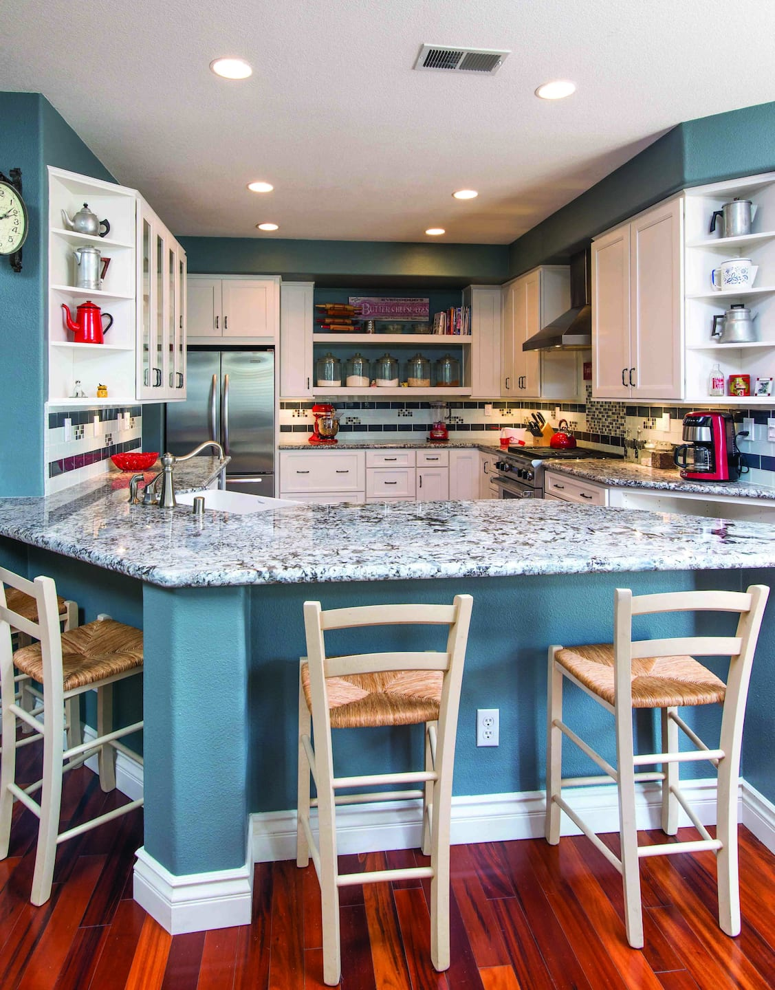 Kitchen With Granite Countertops, Tile Backsplash And Open Faced Cabinets