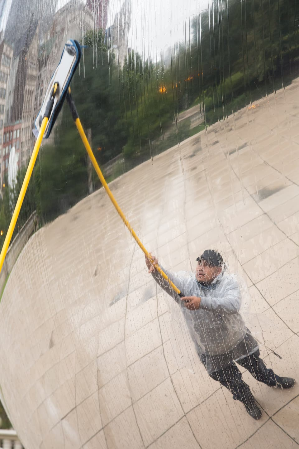 cleaning Cloud Gate sculpture in downtown Chicago