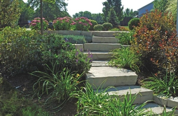President Dan Kjeldberg says his company's fields of expertise include plant maintenance, stone work and pavers. (Photo courtesy of Poul's Landscaping)
