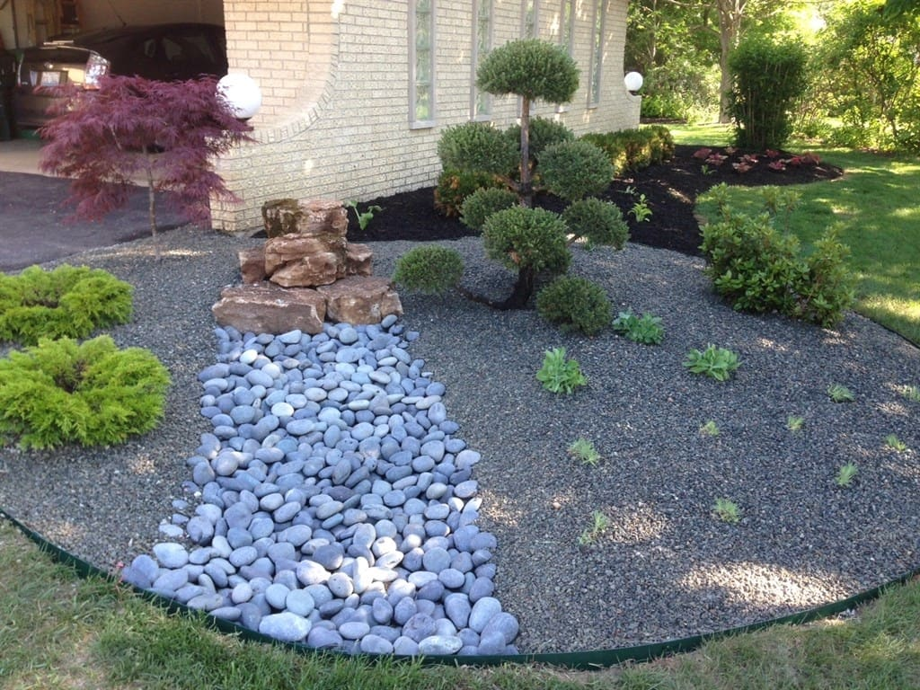The Landscape Designer Mixed Plants And Stones To Create The Modern  Japanese Garden. (Photo Courtesy Of The Ballacks) (Photo By )