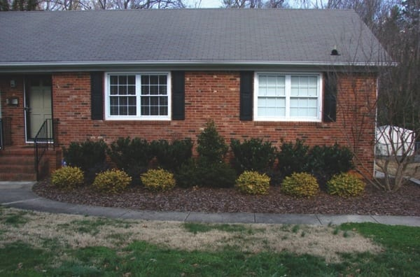 Fresh mulch, in-season plants and trim hedges improve curb appeal. (Photo courtesy Kevin James)