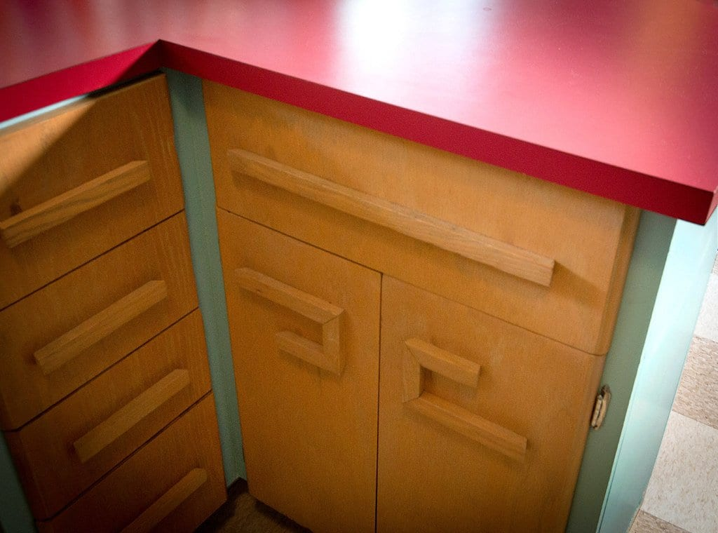Flat panel kitchen cabinet doors with custom crafted handles