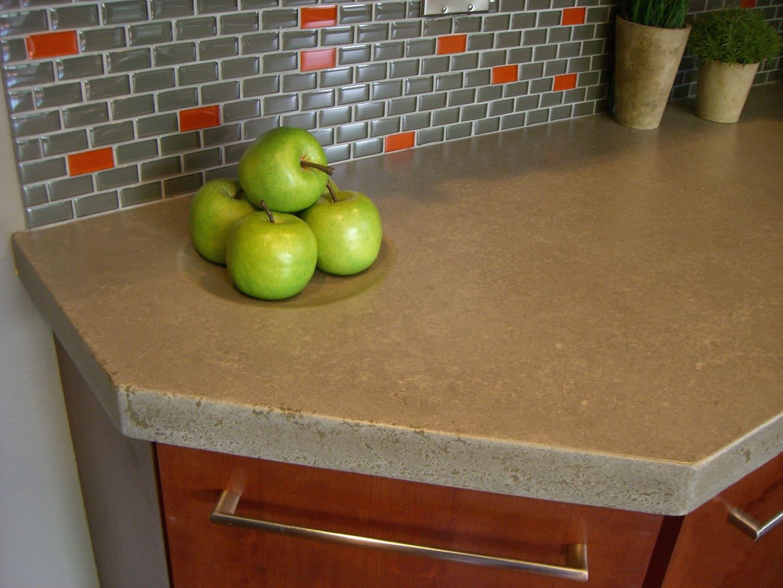 concrete countertops and tile backsplash