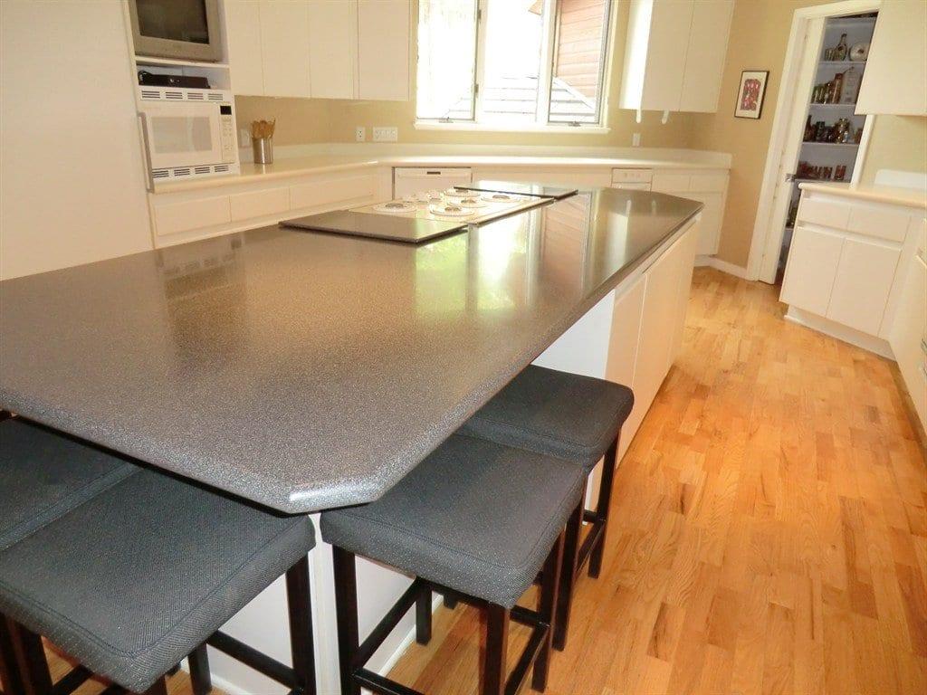 gray corian countertop on white cabinets