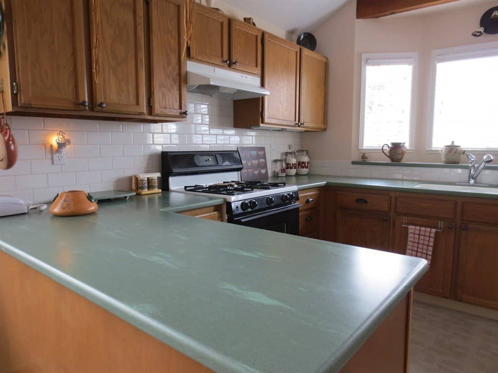 Continuous U-shaped corian countertop on oak cabinets.