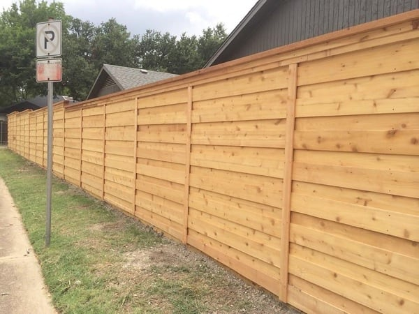 Angie's List member Chad M. says he loves the quality of his custom fence with horizontal cedar boards. (Photo courtesy of member)