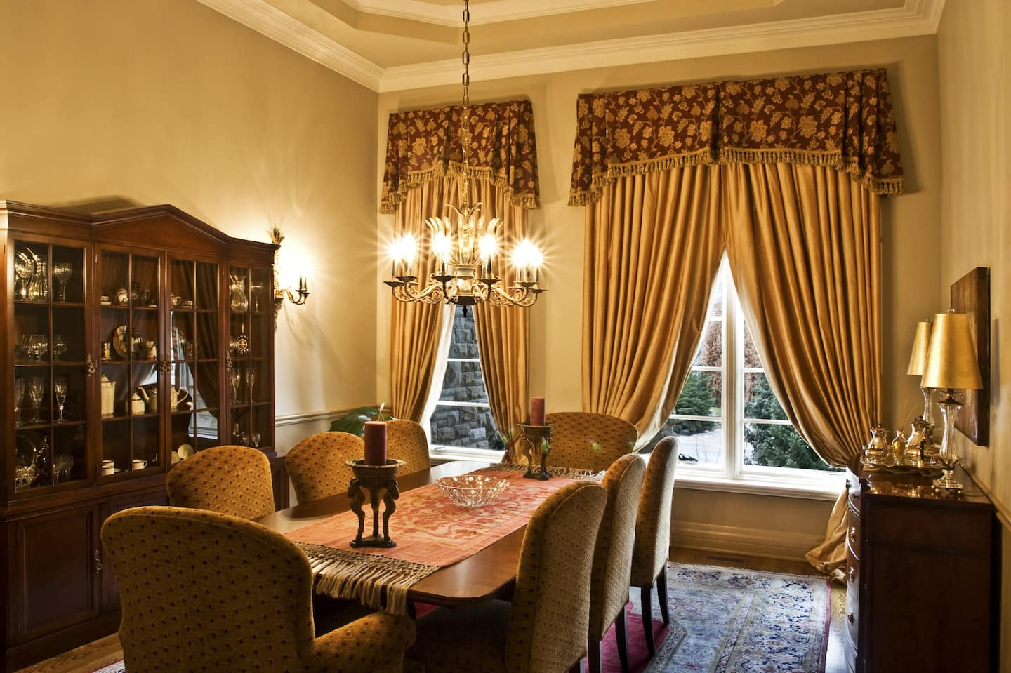 Genial Traditional Formal Dining Room With Gold Curtains And Patterned Valances,  Upholstered Chairs, Large Rug