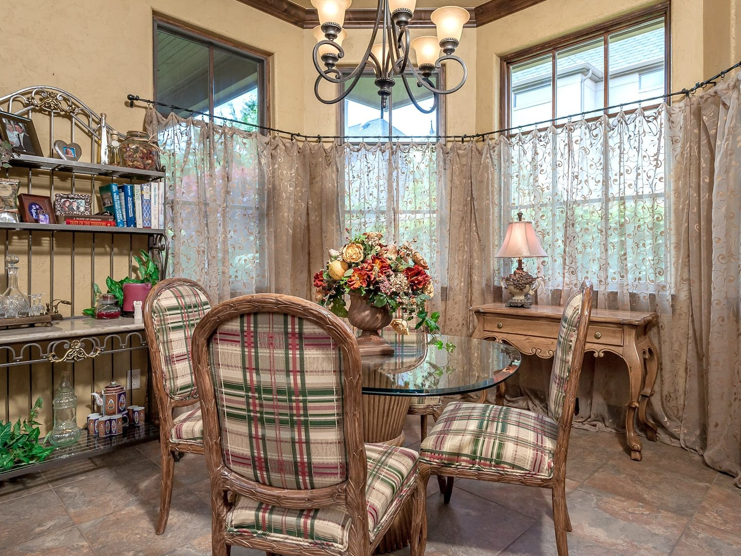 Small Country Dining Room With Sheer Floral Curtains Hung About Two Thirds  Of The Way