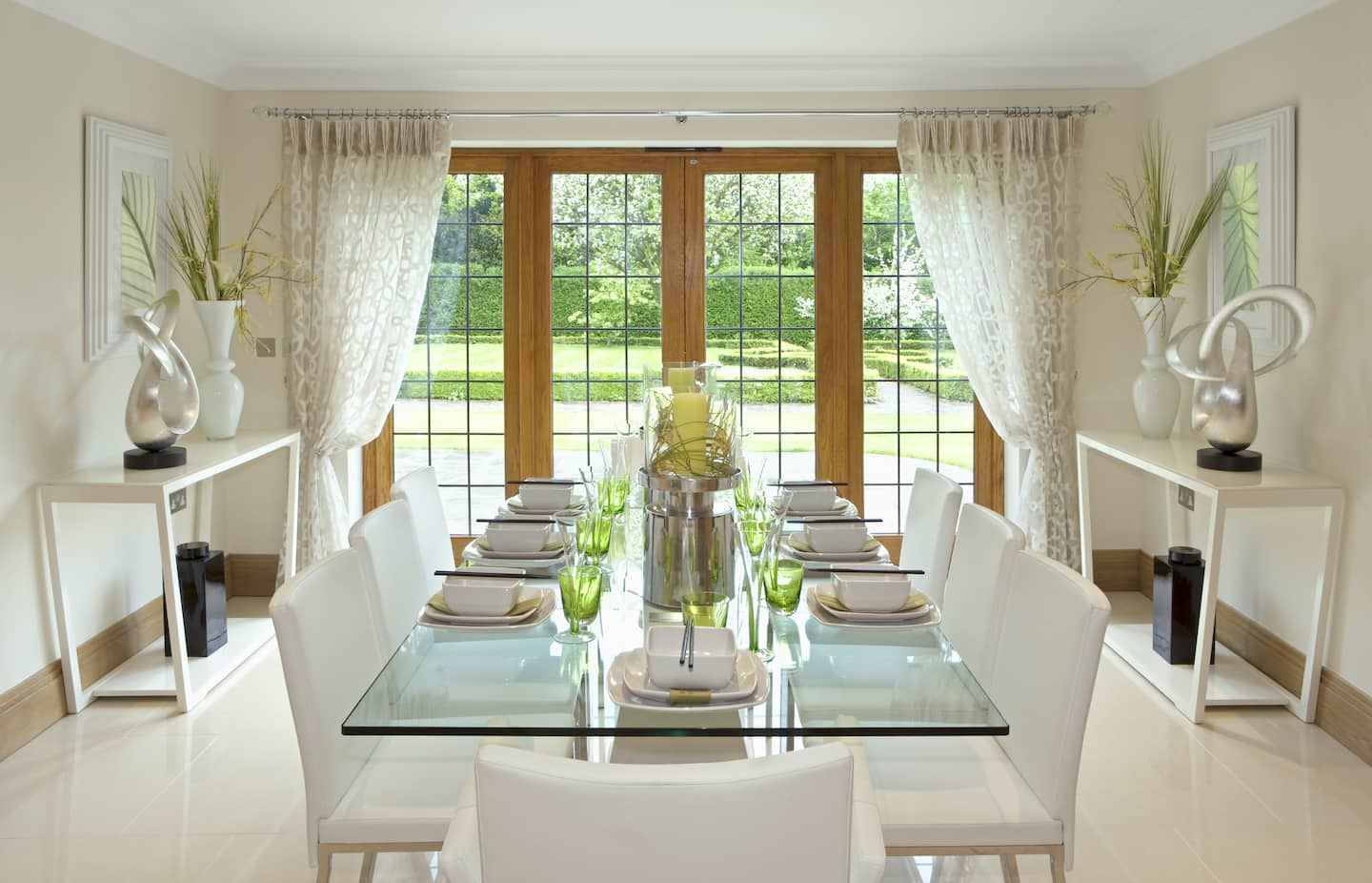 Attrayant Contemporary Formal Dining Room With White Chairs, Glass Table, Garden View  Through Glass Doors