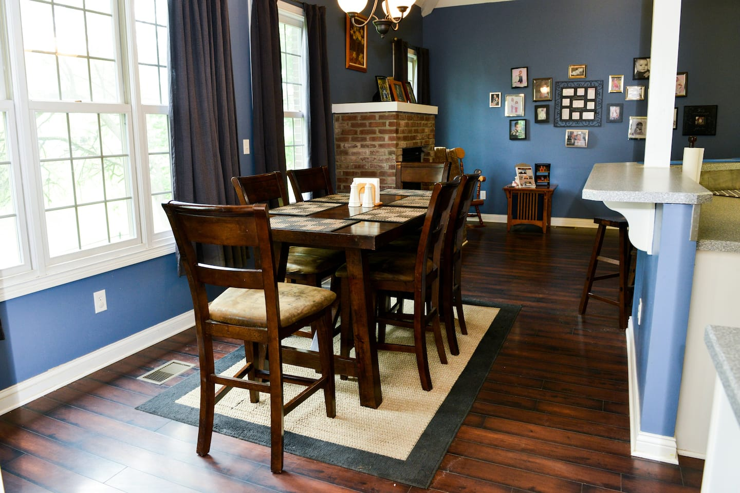Comfortable Contemporary Dining Room With Blue Walls White Trim Dark Curtains And