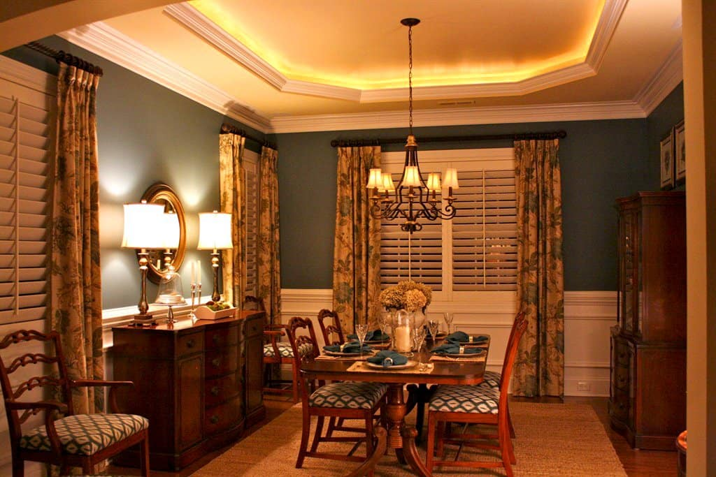 Traditional Dining With Southern And Country Elements, Including Patterned  Drapes Layered Over White Shutters