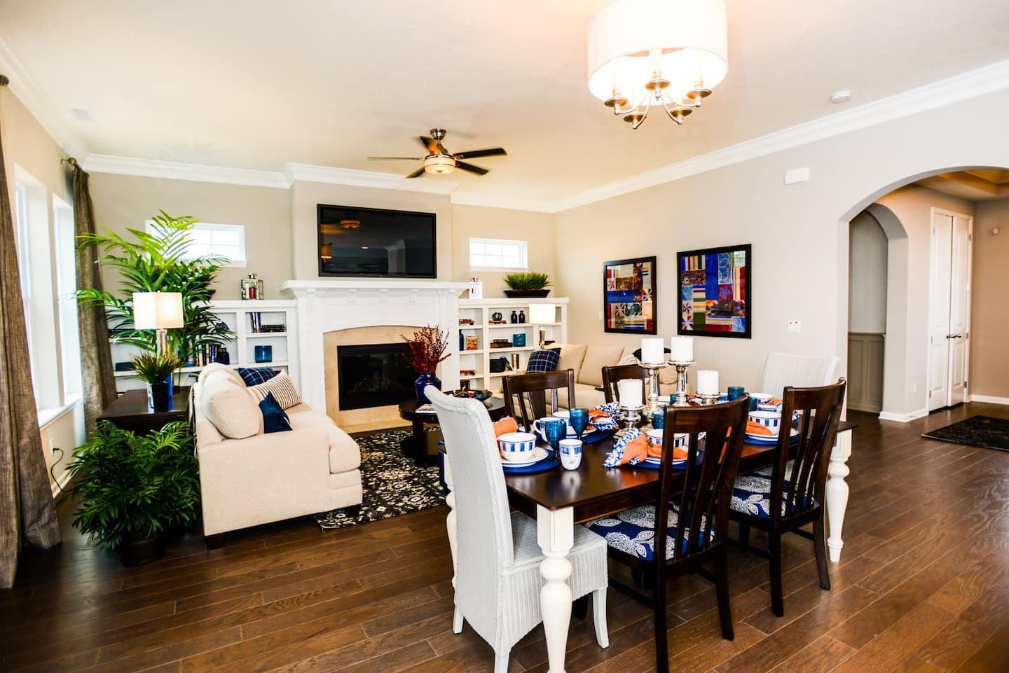 A living room with dining table in the transitional area