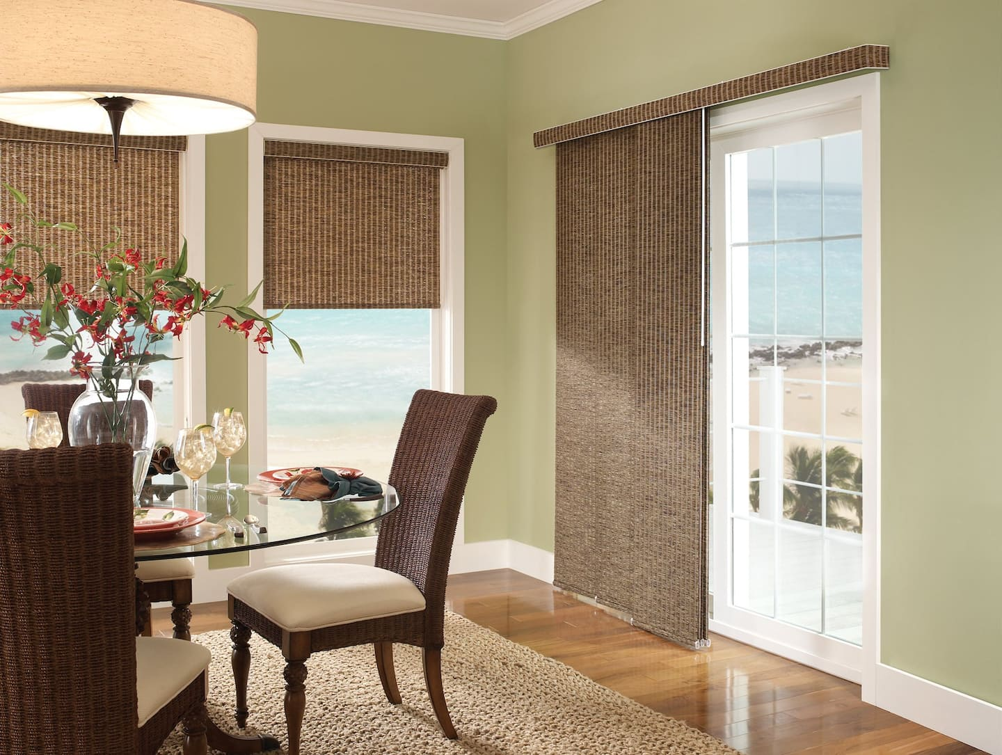 Waterfront dining room with panel track blinds over large windows and sliding glass door
