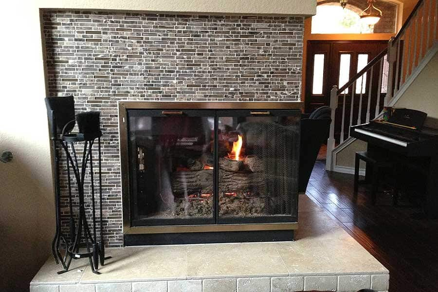 fireplace with glass tile mosaic