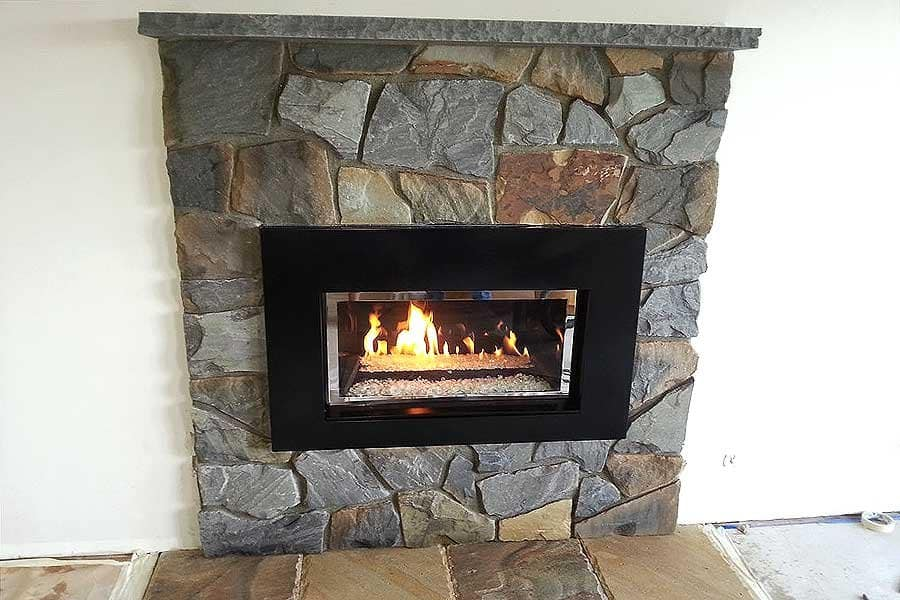 ribbon fireplace with stone surround