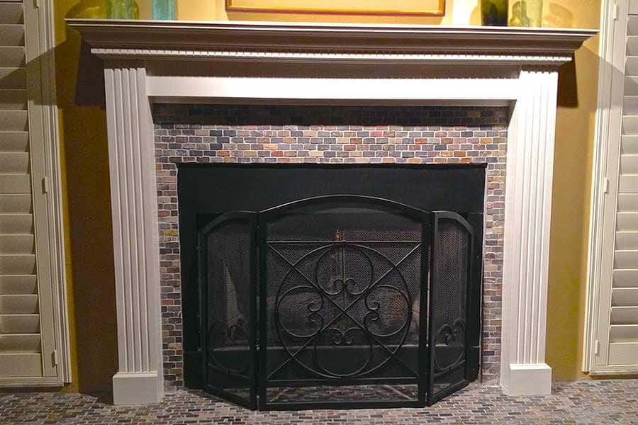 fireplace with new mantle and slate tile
