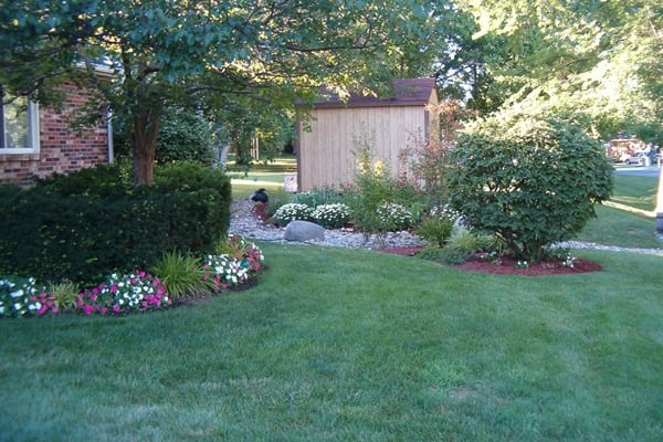 Creating a lush, green lawn begins with proper fertilizing, watering and maintenance, much of which can be done by the homeowner. (Photo courtesy of Angie's List member Dorothy M. of Cincinnati)