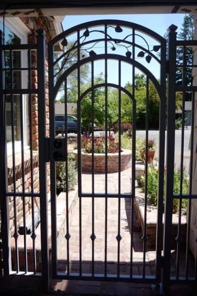 Installation of this beautiful new gate included removal and disposal of the old gate and side panels. (Photo courtesy of Angie's List member Pam Long of Morro Bay, Calif.)